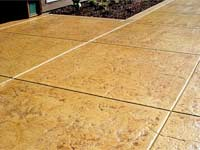 exterior floor stained with irange-crete brushes